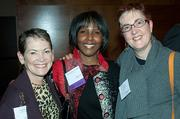 Boston Business Journal's WomenUp honoree Maureen Alphonse-Charles of City Year (center) is flanked by Claire Muhm of Kaplin DeVires, left, and Lisa Wood from Foley Hoag during the social hour.