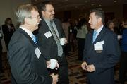 Secure enough with their masculinity to attend the social hour at the Boston Business Journal's WomenUp awards breakfast were, from left: Dave McManus and Michael Mulvena of Alexander Aronson Finning along with Dres Julian of Cohn Reznick, a presenting partner of the event.