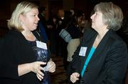 Mass Hospital Association's Kirsten Singleton and Nancy Siopes catch up during the social hour at the Boston Business Journal's WomenUp awards breakfast.