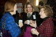 Enjoying conversation over coffee during the social hour at the Boston Business Journal's WomenUp awards breakfast were from left: Veronica Jordan of BioInnovation Advisors, Julie Santosus of Cutwater Capital and JoAnn Cavallaro of DeVava Consulting.