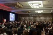 A full banquet room listens to Sheila Lirio Marcelo, founder and CEO of Care.com, keynote speaker at the Boston Business Journal's WomenUp awards breakfast held at the Westin Boston Waterfront Hotel.