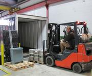 A forklift loads kegs into Yards' new tractor trailer, which sits at a new loading dock.