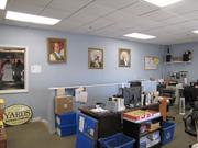 Cramped office space at Yards Brewing features portraits of statesmen.