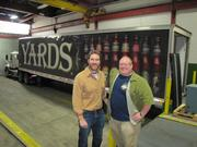 For the first time, Yards Brewing now has a tractor trailer to get kegs and cases to distributors. Pictured are COO Trevor Prichett (left) and President Tom Kehoe.