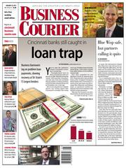"""We devoted most of our Jan. 18 front page to Steve Watkins' story  """"Cincinnati's banks still caught in a loan trap.""""  It examined how Cincinnati's recovering economy was being hindered by problem loans at local banks."""