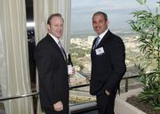 Tom Grunnah and Lane Kommer visit during the Top Brokers reception