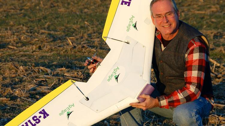 Bret Chilcott, owner, AgEagle LLC, shows off one of the drone aircraft his company builds for agricultural use.
