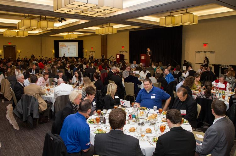 Guests and honorees enjoy the meal during the Best Places To Work luncheon Thursday afternoon at the Hyatt Regency, 400 W. Waterman St.