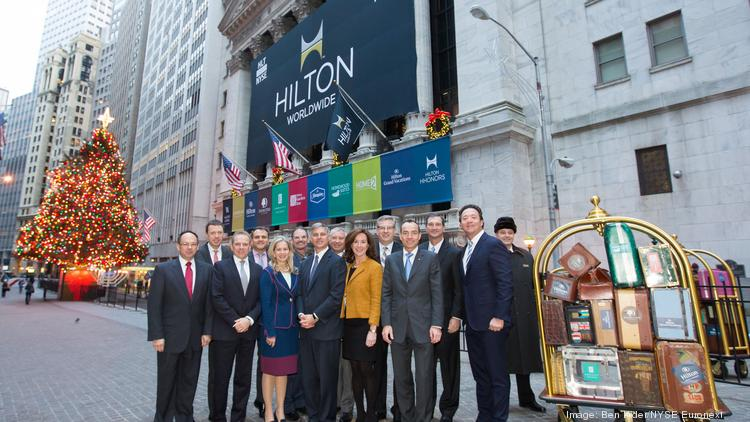 Hilton officials in front of the New York Stock Exchange, decked out with a company logo, when they went public in November of 2013.