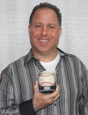 Tristar Productions CEO Jeffrey Rosenberg with a Babe Ruth baseball. Rosenberg has been collecting autographs for more than 40 years.