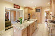 8062 South Drive: The kitchen has stainless steel appliances and granite countertops.