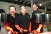 "The Centerplate team, from left, Paul Shiroma, catering manager; Edwin Mizuno, executive chef; and Juan Santana-Mojica show off their smoked applewood kurobuta pork belly hoisin plum sauce with roasted herb fingerling potato at ""Chefs for Hope"" a fundraiser for Haiyan typhoon victims, a benefit for The Salvation Army Haiyan Relief Fund at the Neal Blaisdell last month. The event brought a group of local chefs, entertainers and food and beverage industry professionals together to help raise money for the Haiyan typhoon victims."