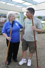 Joan Husted, left, retired executive director of the Hawaii State Teachers Association, and Randy Perreira, executive director of the Hawaii Government Employees Association, help to clean up the campus at Waimanalo Elementary and Intermediate School during the first Labor of Love, a union give-back project.