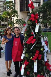 Emcee Tannya Joaquin, an anchor at Hawaii News Now, and Victor Leonardi, divisional special events & volunteer manager for The Salvation Army at The Salvation Army's fourth-annual  Red Kettle and Angel Tree kick-off for Salvation Army at Tamarind Park.