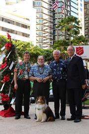 "David Hudson, executive vice president for Central Pacific Bank, Gov. Neil Abercrombie, Mayor Kirk Caldwell, and Maj. John Chamness divisional commander for The Salvation Army, pose for a photo with CPB mascot ""Alex"" at the kick-off of the fourth-annual Red Kettle and Angel Tree season for Salvation Army at Tamarind Park."