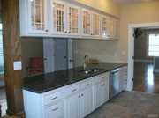 7254 Sarah Ave.: The kitchen features custom cabinets.