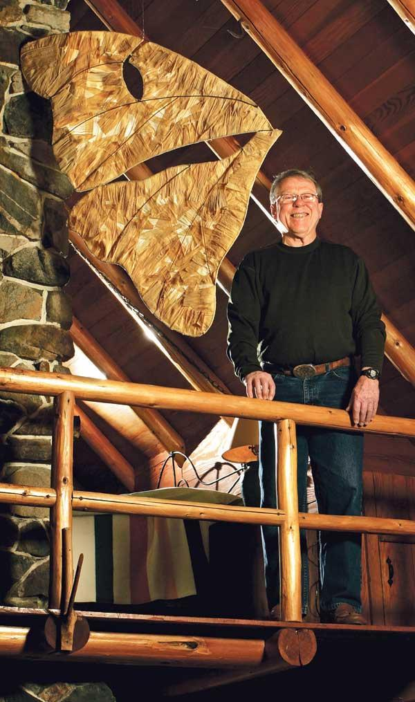 Dave Watt, 71, enjoys a pension-supported Boeing retirement at his log cabin home in Redmond, decorated with a moth wing art piece by his daughter, Marie K. Watt.
