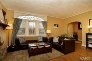 1125 Edward Terrace: A large family room has a fireplace.