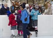 Kelly and Norman Green, Norman at far left and Kelly at far right, officially open their namesake ice rink at Klyde Warren Park Friday.