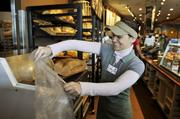 Bread is bagged at Stapleton's Panera Bread Co., where Bill Husted interviews Mayor Michael Hancock and first lady Mary Louise Lee.