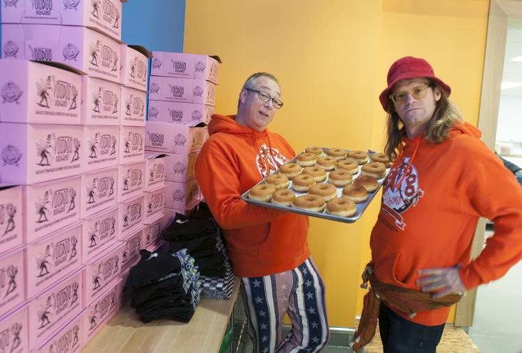 """Kenneth """"Cat Daddy"""" Pogson and Tres Shannon hours before the soft opening of their  Voodoo Doughnut store in Denver."""