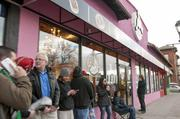Tim Jackson, CEO of the Colorado Automobile Dealers Association (blue shirt) waits in line for the opening of Voodoo Doughnuts on Colfax.