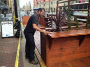 22.Jorge Sanchez of Chacho's put in the first curb café on San Fernando Street in March.