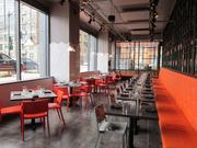 The 117-seat dining room includes bright orange accents like its sister restaurant, Al Dente.