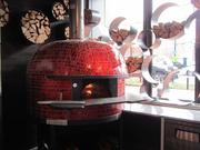 A wood-burning oven imported from Italy at Alba Osteria
