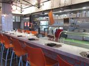 A chef's table in Alba Osteria faces the cheese and charcuterie cases as well as the open kitchen.