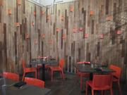 A private dining space is paneled with wood reclaimed from a crayon factory in Ohio.