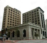 The Laura Street Trio  April 2: SouthEast Group, led by managing partner Steve Atkins, acquires the Laura Street Trio and Barnett Bank Building for $3 million, financed by a $3 million mortgage from Jacksonville Jaguars owner Shad Khan.  The group is still working on financing the project, which is slated to include a Courtyard by Marriott hotel, retail and restaurants in the trio and an innovation hub in the Barnett Building.