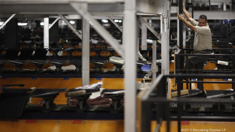 UPS Worldport at Louisville International Airport is the shipper's largest air sorting hub. The company has posted lower earnings in the first quarter of 2014 compared to the same period a year ago.