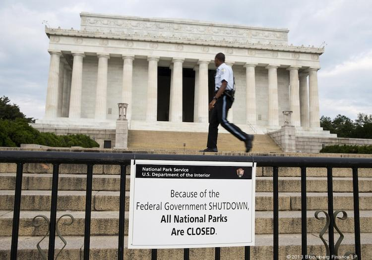 A Park Police officer walks passes a sign announcing the closure of the Lincoln Memorial due to the partial government shutdown that began Oct. 1.