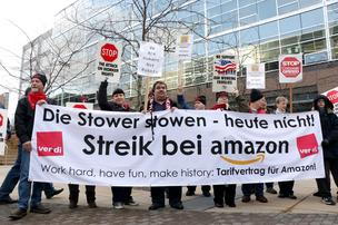 Members of a number of different local unions rally at Amazon's headquarters in Seattle in support of union members from the German union Ver.di who went on strike in Germany over wages and working conditions. The banner in German translates to