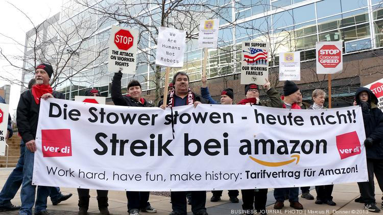 """Union members rallied at Amazon's headquarters in Seattle late last year. The banner in German translates to """"The stowers are not stowing today! Strike at Amazon."""""""