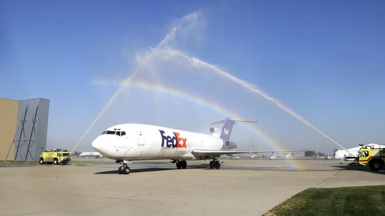 A retired Boeing 727-200F gets a water salute (and rainbow) from firetrucks as it lands at McClellan Business Park to serve for training Sacramento City College students. A similar aircraft will serve as a classroom in Liberal.