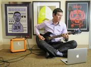 Sonny Mayugba, executive vice president of digital strategy, AugustineIdeas, is photographed with his guitar in his office. He's a man of many talents and business endeavors, from his full-time job to co-founding a restaurant and bar to launching a social network. From the story:  Sonny Mayugba, executive vice president of digital strategy, AugustineIdeas