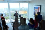 """Students check out an Andy Warhol work called """"Louis Brandeis"""" (from portraits of Jews of the 20th Century)."""