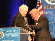 """Former U.S. Sen. Hank Brown (left) shares a bipartisan laugh with former U.S. Sen. Gary Hart at """"America's Global Leadership: Impact on Colorado"""" on Monday."""