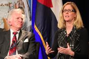 """Former U.S. Sen. Gary Hart and Ellen Sandberg, executive director of the CH2M Hill Foundation, during a panel discussion at """"America's Global Leadership: Impact on Colorado"""" on Monday."""