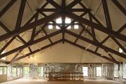 The expansive rafters in the Rookery bar betray the Carriage House's previous hayloft. The rafters remain in place today above a very comfortable room that's ideal for small gatherings, pool and imbibing. The building's HVAC system ably keeps the space toasty in the winter and cooler in the summer.