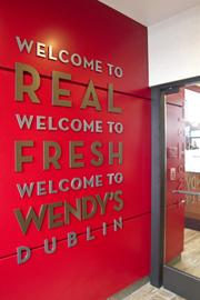 """A sign at the restaurant's entrance reinforces the """"fresh"""" message at the core of Wendy's branding for many years."""