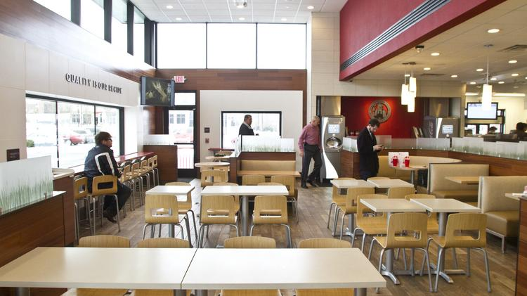 The redesigned wendys has booths and a bar area among its seating options