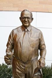 """A statue of Dave Thomas commemorates the Wendy's founder outside the new flagship. The statue by Matthew Gray Palmer, a Washington state-based artist, stands 6'2"""" and weighs 300 pounds."""