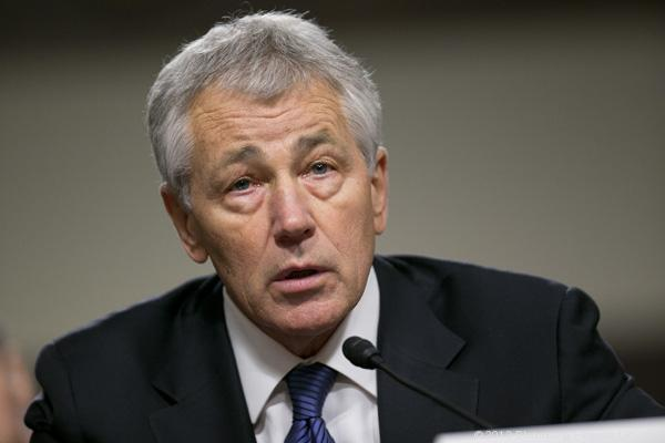 Defense Secretary Chuck Hagel, seen in this Jan. 31 file photo, says the deployment of a U.S. ballistic missile system to Guam is in response to North Korea's threats to attack the U.S. base there, as well as Hawaii and the West Coast.