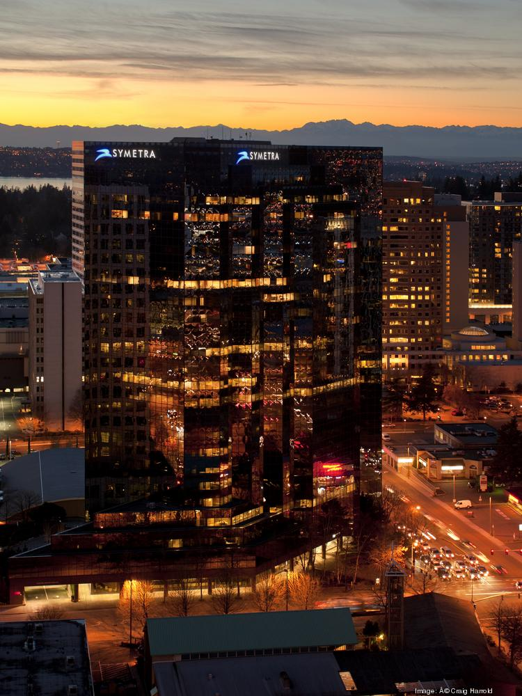 Symetra Financial Center in downtown Bellevue is for sale along with eight other office properties in the Puget Sound region. The decision to sell comes as commercial property values are climbing.