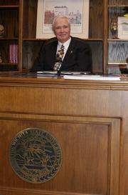 Wichita State University President John Bardo uses the desk of former university President Clark Ahlberg. It features a university seal on the front.