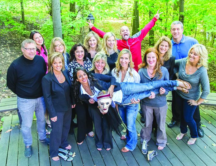 "Executive Staffing Solutions employees have fun planting the ""scary head"" at people's desks during Halloween."