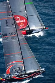 Alinghi of Switzerland, foreground, races against Emirates Team New Zealand during the fourth day of the 32nd America's Cup Match in Valencia, Spain, Wednesday, June 27, 2007.  America's Cup sailing champion Alinghi, which lost a court fight yesterday to prevent Larry Ellison's BMW-Oracle from being the official challenger in the next regatta, said the earliest it is willing to defend its title is May 1, 2009. Photographer: Ivo Rovira/Alinghi via Bloomberg News.